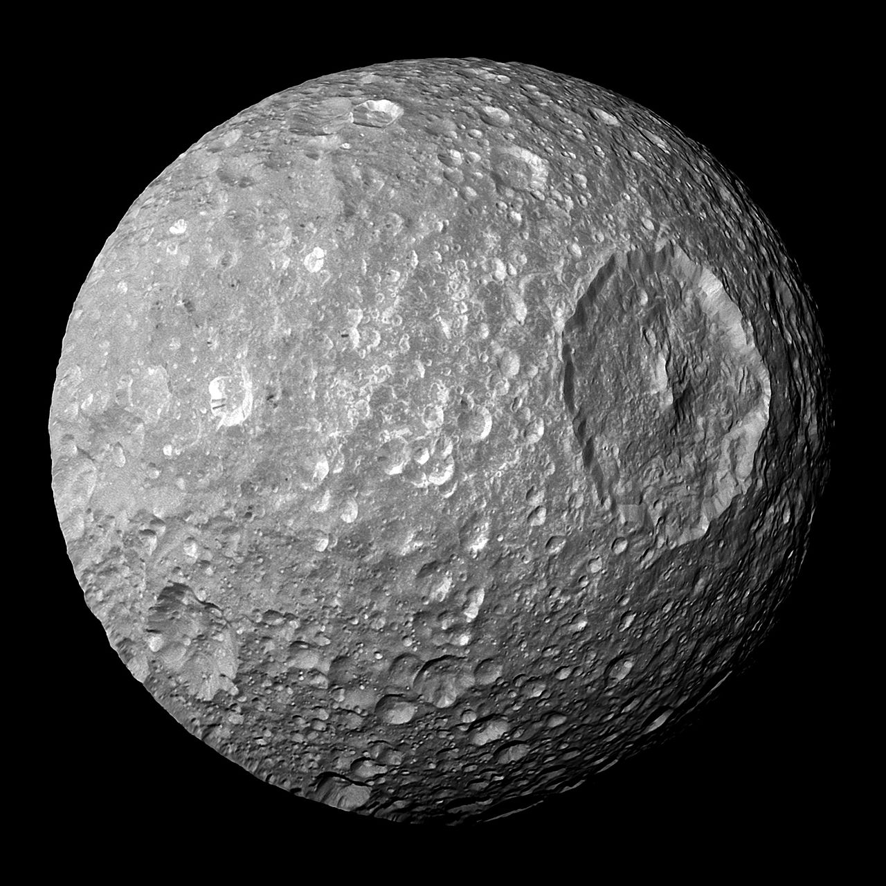 In this view captured by NASA's Cassini spacecraft on its closest-ever flyby of Saturn's moon Mimas, large Herschel Crater dominates Mimas, making the moon look like the Death Star in the movie