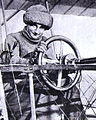 Mme. la Baronne de Laroche, aviatrice, au poste de direction d'un biplan Voisin (c. 1910).jpg