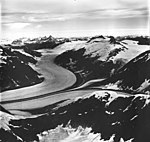 Morse Glacier, junction of valley glacier with dark medial moraines and hanging glaciers on the mountainsides, August 27, 1968 (GLACIERS 6060).jpg