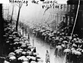 Mourners line the streets during a funeral procession for victims of the Triangle fire, April 5, 1911 (5279748598).jpg