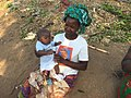 Mozambican woman taking care of baby.jpg