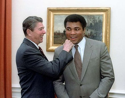 President Ronald Reagan with Ali in the Oval Office in 1983 MuhammadAliundRonaldReagan.jpg