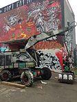 Mural and abandoned machinery at Teufelsberg.jpg