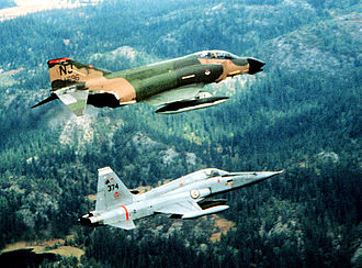 108th Wing - McDonnell F-4D-28-MC Phantom AF Serial No. 65-0696 of the 141st TFS with a Norwegian Air Force Northrup F-5E Freedom Fighter while deployed to NATO on 1 September 1982. After its retirement in 1985, this aircraft was briefly in private hands as civil registration N402AV, then preserved at the Heritage Aviation Airpark, Palmdale, California.