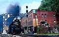 NKP 765 rolls through downtown Thurmond, WV in October 1985.jpg