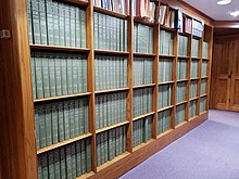 Bookshelves holding 280 volumes of the National Union Catalog (NUC)