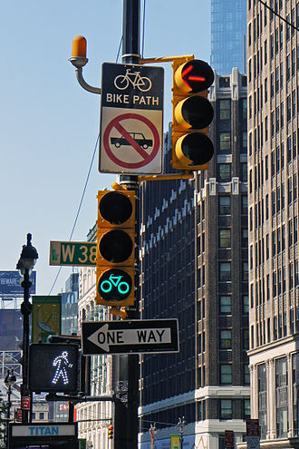 Bicycle safety - Signs and signals for both bicycles and drivers at an intersection in New York City.