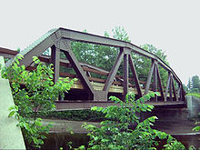 A relatively small steel bridge seen from the side.
