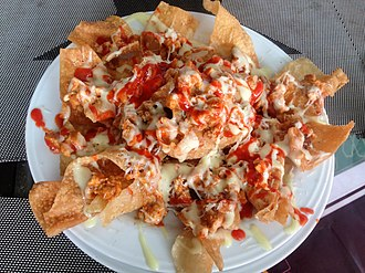 Nachos - Nachos with nacho cheese and tomato sauce