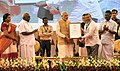 Narendra Modi gave away the Sant Kabir awards to the weavers for outstanding contributions, at the launch of the India Handloom brand, on the occasion of the National Handloom Day, in Chennai (2).jpg