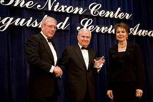 Julie Nixon Eisenhower - Julie Nixon Eisenhower presents the Nixon Center's Distinguished Service Award to Defense Secretary Robert M. Gates, February 2010