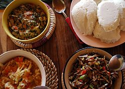 Nshima with three types of relish.
