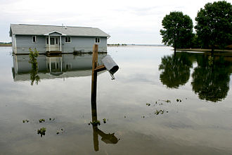 Iowa flood of 2008 - A house in Oakville sits surrounded by water, after the Iowa River burst its banks.
