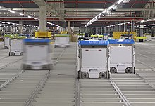 Bots move on the grid inside an Ocado warehouse