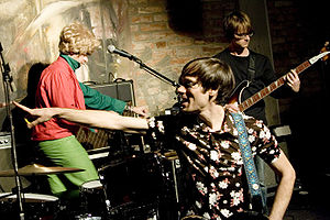 Of Montreal - Kevin Barnes, Jamey Huggins, and Matt Dawson on stage in Sweden, 2005.