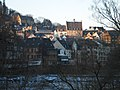 Old town (Oberstadt Marburg) only upper part in sun, from foot- and bicycle-bridge Hirsefeldsteg, town hall, castle, trees in winter, January 2017-01-19.jpg