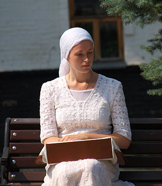 Christian headcovering - Orthodox Christian woman in Ukraine. Female believers are required to cover their head entering churches and monasteries.