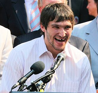 "Alexander Ovechkin - Ovechkin addresses the crowd in front of the Wilson Building in Washington, D.C. after receiving the key to the city. He has just said, ""Everybody have fun. No speed limit today."""