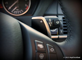 "Paddle shifter (labelled ""+"") in a 2013 BMW X5 Paddle Shifter - 2013 BMW X5 xdrive 35i (9709131265).jpg"