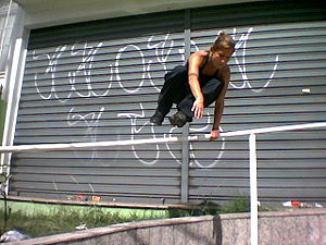 Parkour - A traceuse vaults an obstacle.