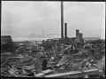 Part 1 of a 2 part panorama showing the aftermath of a fire at Cook's Cooperage, Petone, 14 January 1914. ATLIB 286532.png