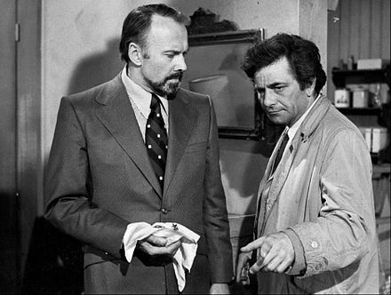 "As Lt. Columbo with Richard Kiley in episode ""A Friend In Deed"" aired on 5 May 1974. Peter Falk Richard Kiley Colombo 1974.JPG"