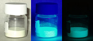 Phosphorescence - Phosphorescent, europium-doped strontium silicate-aluminate oxide powder under visible light, long-wave UV light, and in total darkness