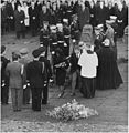Photograph of Jacqueline Kennedy stepping away from the grave of her husband at Arlington National Cemetery, holding... - NARA - 200451.jpg