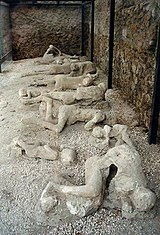 The 79 eruption of Mount Vesuvius completely destroyed Pompeii and Herculaneum. Today plaster casts of actual victims found during excavations are on display in some of the ruins.