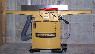 Jointer - High end or professional grade Jointer-planer discernible by the integral vacuum reservoir, metal blade guard, and the very long infeed and outfeed tables.  The moderately wide (4-8 inches, 5-10 centimeter) tables make it suitable for single side power planing operations.