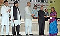 Pranab Mukherjee presenting the National Award for Teachers-2012 to Smt. Pravinaben Madhavlal Patel, North Gujarat, on the occasion of the 'Teachers Day', in New Delhi. The Union Minister for Human Resource Development.jpg