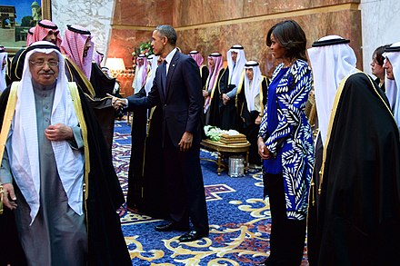 Michelle and Barack Obama with King Salman of Saudi Arabia and members of the Saudi royal family, January 27, 2015. President and First Lady Obama, With Saudi King Salman, Shake Hands With Members of the Saudi Royal Family.jpg