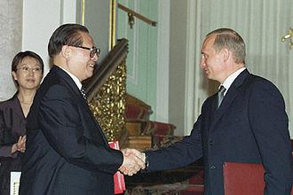 2001 Sino-Russian Treaty of Friendship - Image: Putin and Jiang Zemin document signing ceremony 2001