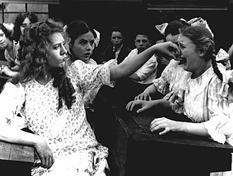 Popularity - From the 1917 silent film Rebecca of Sunnybrook Farm, this image shows one girl behaving with overt aggression towards another girl.