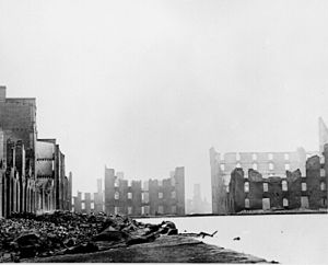 Shells of the buildings of Richmond, silhouetted against a dark sky after the destruction by Confederates fleeing advancing Union forces, 1865.