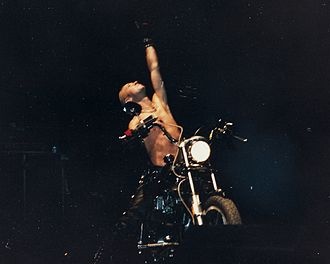 Judas Priest - Rob Halford in 1988. One of Priest's trademark stage stunts was to have Halford ride a motorbike on stage.
