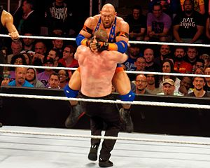 Professional wrestling attacks - Ryback performing a Thesz Press on Kane