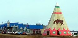 Strip mall and tipi in Rycroft