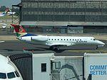 SAA AirLink Embraer 135 ZS-SYT at JNB (26244075932).jpg