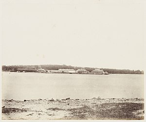 Spectacle Island (Port Jackson) - Spectacle Island viewed from the east, 1872. Buildings (l-r): labourers' house, covered way, main magazine, residences.