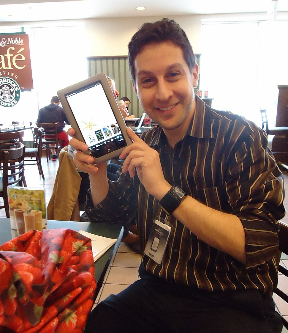 Salesman demonstrating Nook tablet in a Barnes & Noble bookstore