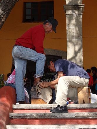 Shoeshiner - Shoeshiner at work in Tepotzotlan, Mexico.