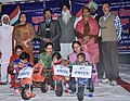 Smt. D.K. Mahiya, DEO (S) and Drug Deaddiction Campaigner, Master Avtar singh Sohal with the winners of healthy baby show organised by PIB Jalandhar at the Bharat Nirman Public Inforamtion campaign, at Jhabal.jpg