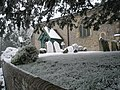 Snow covered tombstones in the churchyard - geograph.org.uk - 752326.jpg