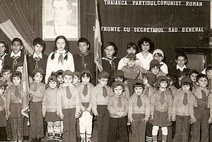 Union of Communist Youth - Members of Şoimii Patriei around 1983, standing beneath a portrait of Ceauşescu