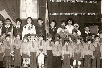 Union of Communist Youth - Members of Şoimii Patriei around 1983, standing beneath a portrait of Ceauşescu