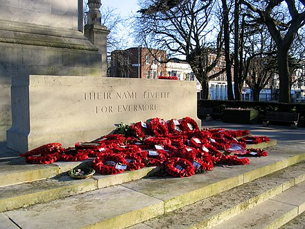 Poppy wreaths laid around the Stone of Remembrance Southampton Cenotaph with Flowers.jpg
