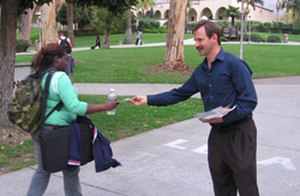 Vegan Outreach - Volunteer Stewart Solomon leaflets for the Adopt-A-College program