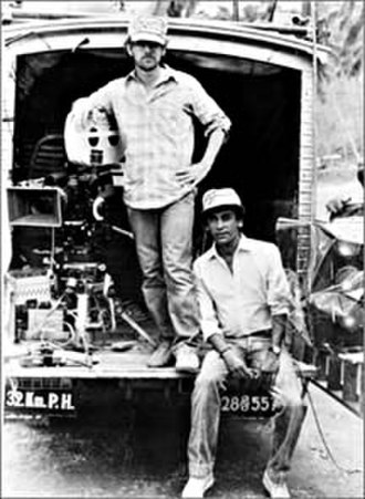 "Filmmaking - Steven Spielberg (standing) with Chandran Rutnam in Sri Lanka, during the production of ""Indiana Jones and the Temple of Doom"" (released 1984)"