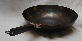 Wok - A stick-handled flat-bottomed peking pan. While the surface looks like Teflon, it is actually well-seasoned carbon steel